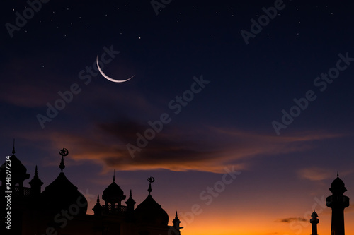 Obraz na plátně mosque at sunset and crescent moon over silhouette mosque,religion of islamic an
