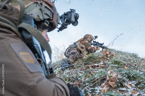 Canvas Print paratrooper aiming in the scope of his weapon during a military training in sout