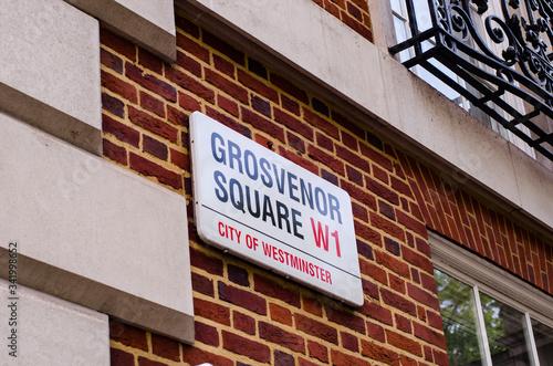 Fotografia, Obraz London- Grosvenor Square street sign, a landmark square in Mayfair area of the W