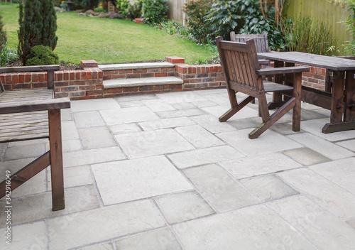 Fotomural New stone garden patio in backyard, UK
