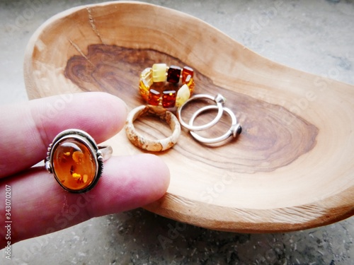 Fotografering Cropped Hand Holding Amber Ring