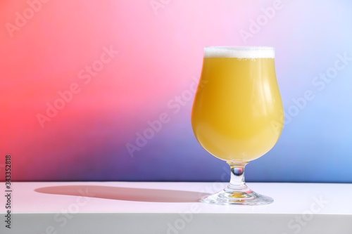Fototapeta A hazy New England India pale ale beer in a tulip shaped glass against a soft background