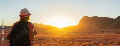 Canvas Print Woman enjoying the beautiful sunset in the Wadi Rum desert in Jordan