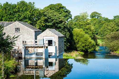 Fotografering Heron Corn Mill on the river Bela Beetham Cumbria UK