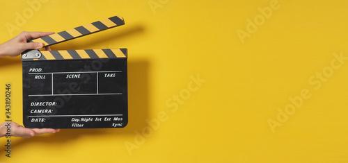Obraz na płótnie Hand is holding clapper board or movie slate
