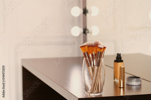 Obraz na plátně Decorative cosmetics and tools on dressing table in makeup room, close up