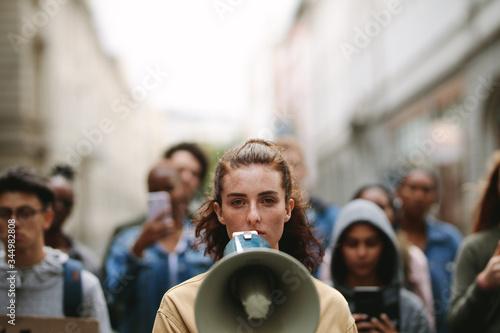 Carta da parati People on strike protesting with megaphone