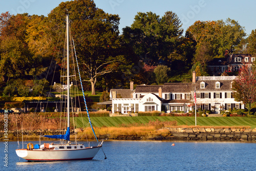 Photo A sailboat is moored at a luxury waterfront homes in Greenwich Connecticut