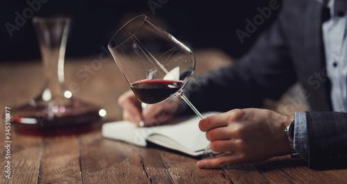 Fotografia Sommeliers male hold glass red wine tasting degustation card