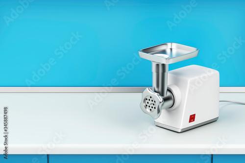 Fotografia Electric meat grinder on kitchen table