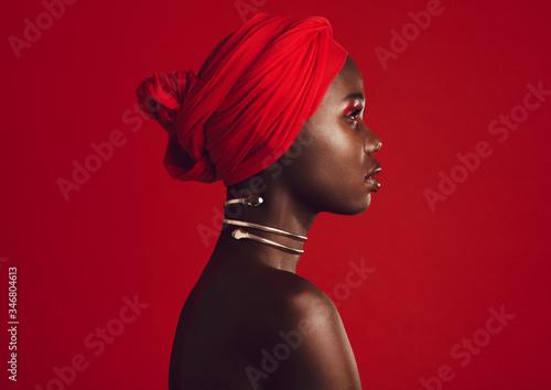 Obraz na plátně Stylish woman wearing red turban