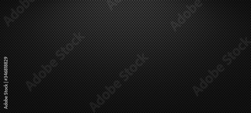 Foto Vector carbon fiber texture. Dark background with lighting.