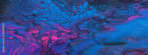 art photography of abstract marbleized effect background. Black, blue, pink and purple creative colors. Beautiful paint