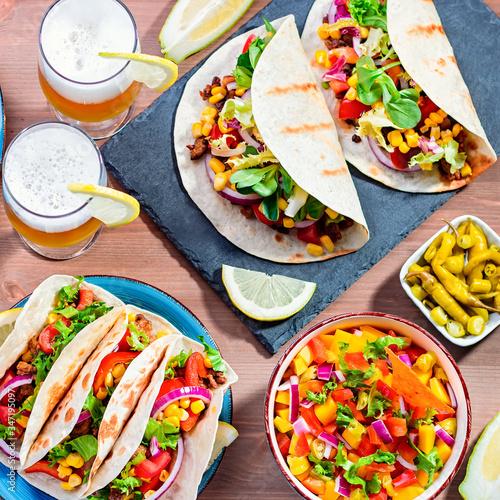 Canvas Print Table with tacos, mango salsa, nachos with sauce, guacamole, lemon beer