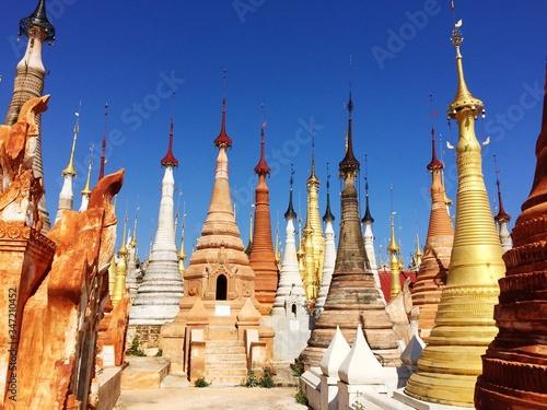 Photo Stupas Against Blue Sky