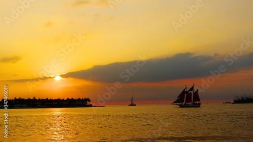 Fotografie, Obraz Ship Sailing Into Scenic Sunset
