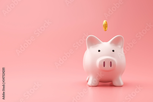 Fotografija Piggy bank and golden coin on pink background with saving money concept