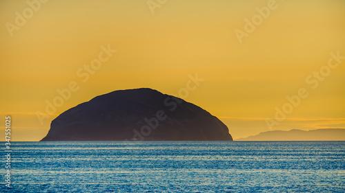 Fotografering sunset over the sea Scotland