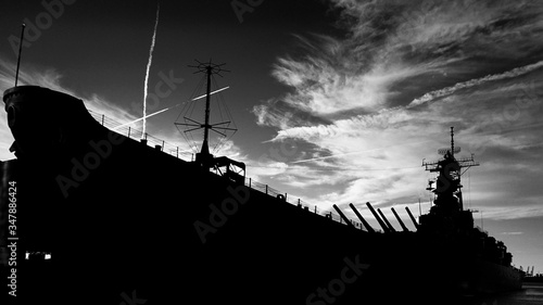 Leinwand Poster Low Angle View Of Silhouette Us Navy Ship Against Cloudy Sky