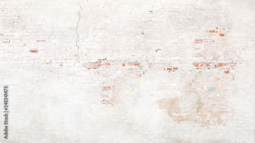 Fotografija Brick wall texture with white shabby stucco, plaster