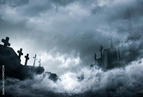 Fotografija Cemetery or graveyard in the night with dark sky and white clouds