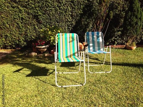 Deck Chairs On Grassy Field Tapéta, Fotótapéta