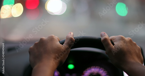 Photo Driver POV hands holding steering wheel waiting