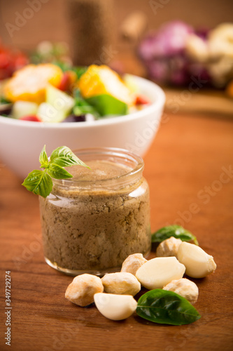 Canvas Print Close-up Of Garlic Paste In Jar By Food On Wooden Table