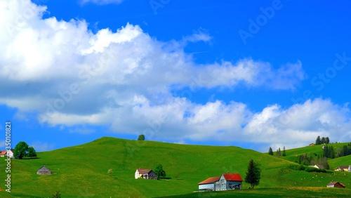Obraz na plátne View Of Farmhouses On Hill
