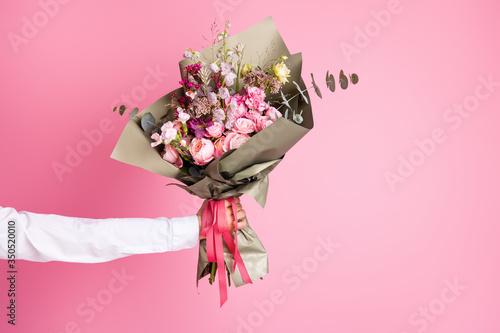 Obraz na płótnie Photo of cropped man arm hold big bright decorated bunch giving girlfriend valen