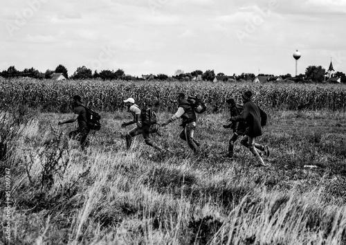 Refugees Running On Field Fototapeta
