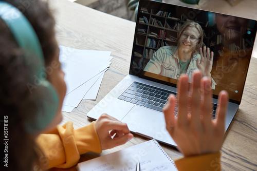 Hispanic teen girl school college student distance learning waving hand studying with online teacher on laptop screen Fotobehang