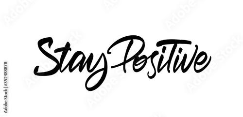 Fototapeta Handwritten brush type lettering fo Stay Positive