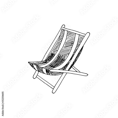 Fotografia Folding deck lounge chair for summer rest, country house, garden sitting and suntanning