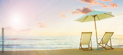 Foto Background with couple of deck chairs at sunset, Travel concept, Summer backgrou