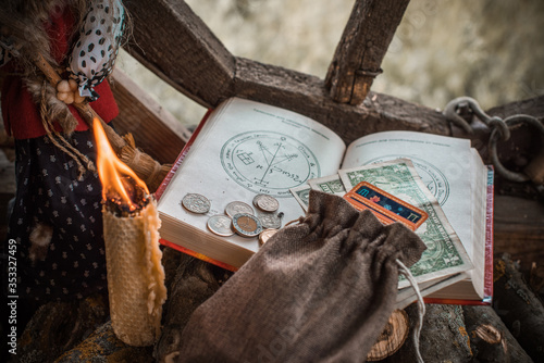 Photo Ritual and spell for attracting money, pagan magic and fate prediction, work of