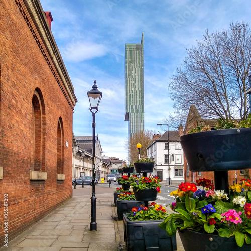 Billede på lærred Sunny day and flowers in Manchester