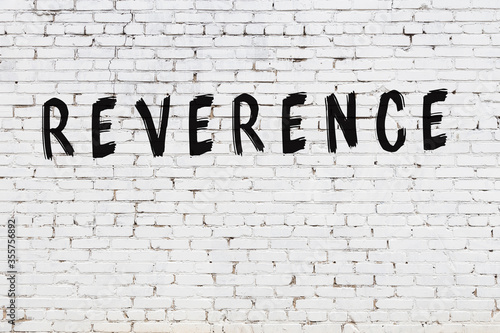 Fotografía Word reverence painted on white brick wall