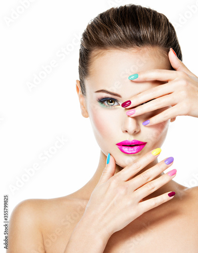 Canvastavla Beautiful woman  with colored nails and pink lips .