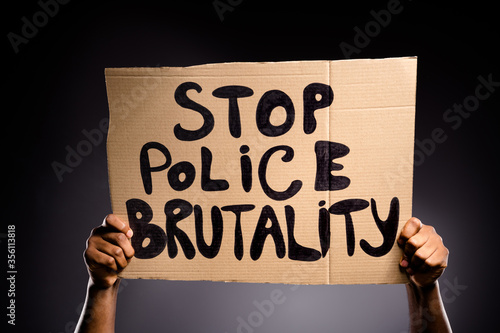 Tableau sur Toile Close up photo of afro american hand hold cardboard banner show stop police brut