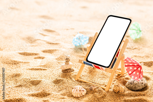 Canvas Smartphone and wooden deck chair on the beach - holiday (vacation)