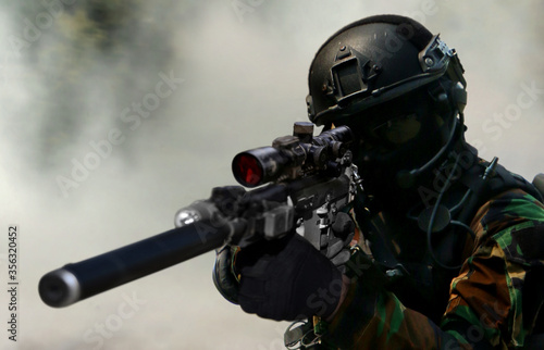 Fototapeta Army sniper during the military special operation in close up