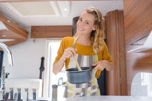 Slika na platnu woman cooking in her motorhome