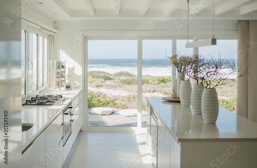 Wallpaper Mural Modern white kitchen with ocean view