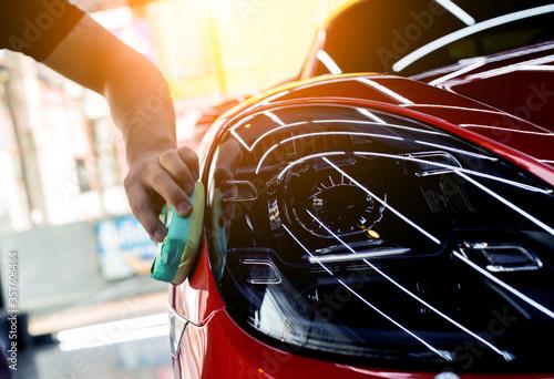 Car service worker applying nano coating on a car detail Fototapete
