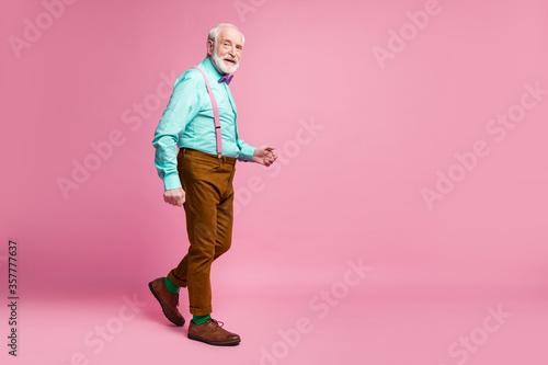 Fényképezés Full length profile photo of stylish grandpa good mood walking down street wear