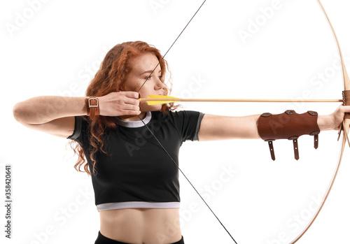Obraz na płótnie Beautiful female archer with bow on white background