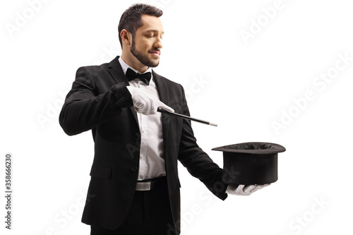 Wallpaper Mural Magician performing a trick with a magic wand and a top hat