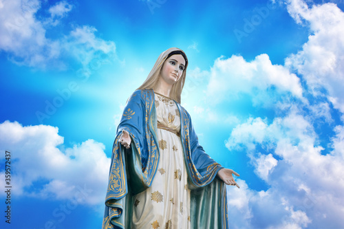 Carta da parati Our lady of grace virgin Mary with Bright Blue Sky and beautiful clouds with abs