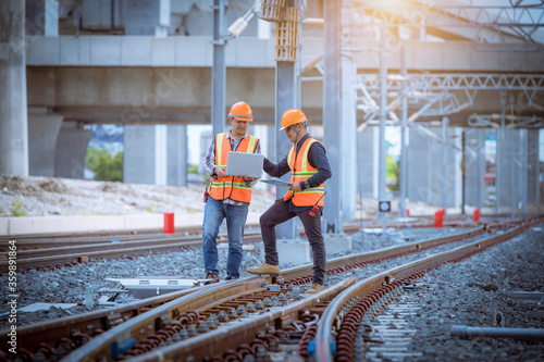 Photo Engineer under discussion inspection and checking construction process railway switch and checking work on railroad station
